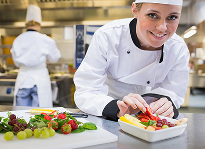 Female chef plating up